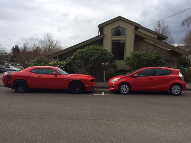 Hellcat cozy with Prius.JPG
