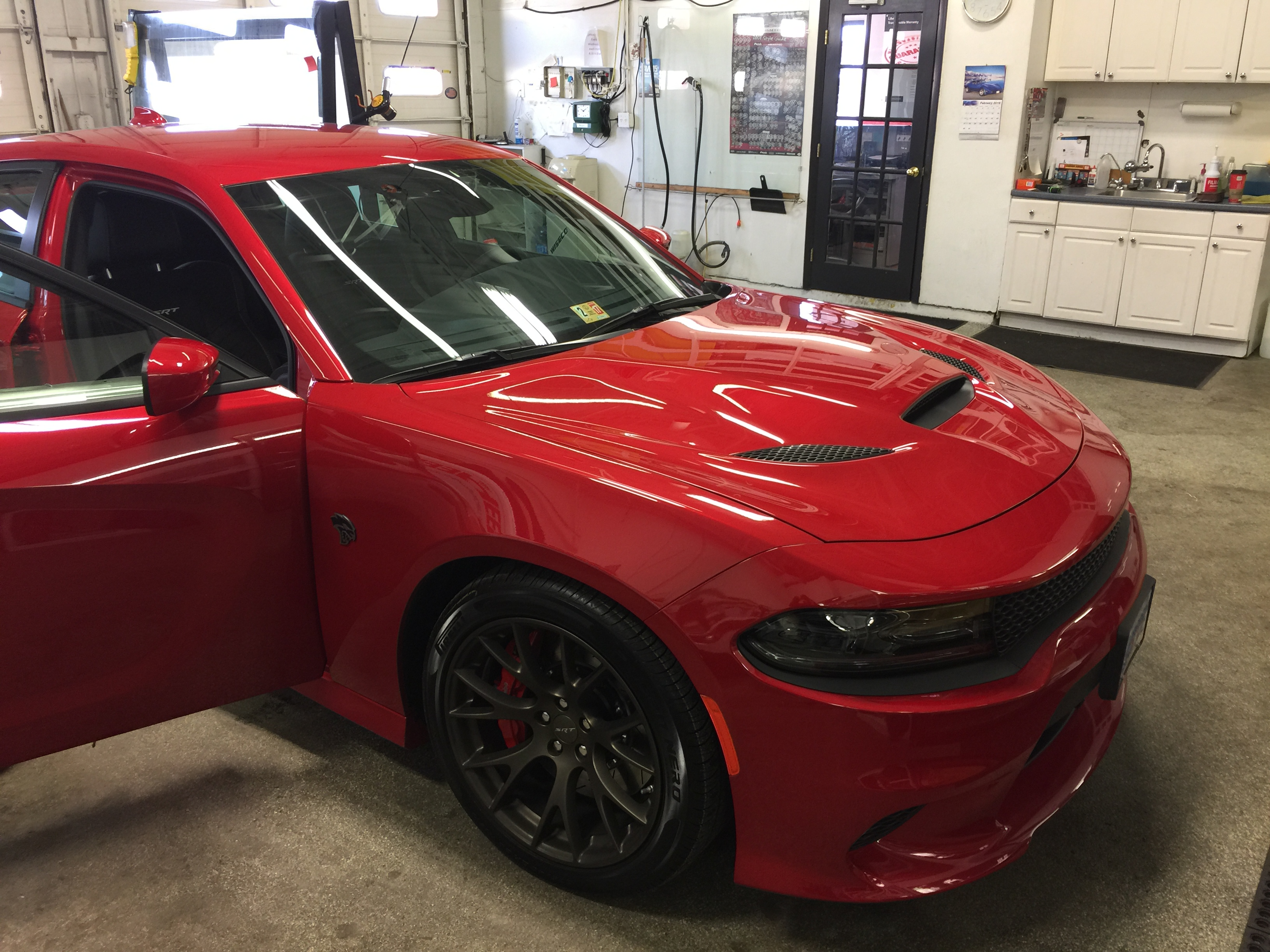I Have The 1st Black Wrapped Hellcat Hood On A Red Charger